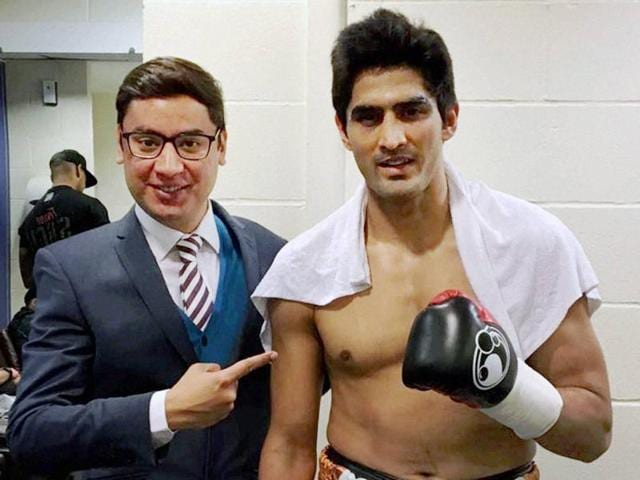 Indian boxer Vijender Singh pose after his win in fourth consecutive bout in Liverpool.