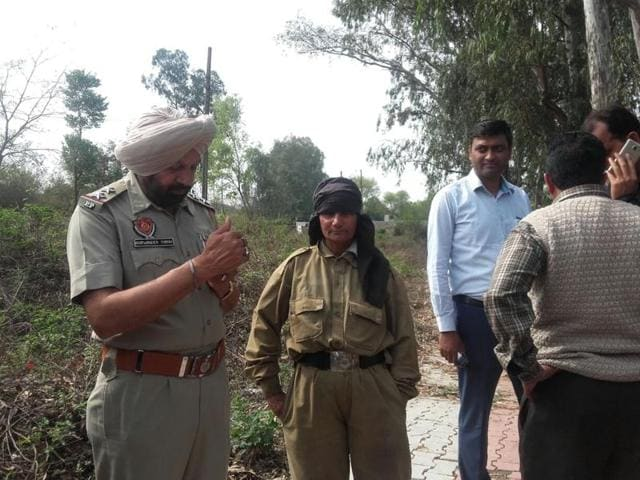 Police quizzing a woman who was held wearing a CRPF dress near Pathankot Cantonment area on Friday, March 18, 2016.