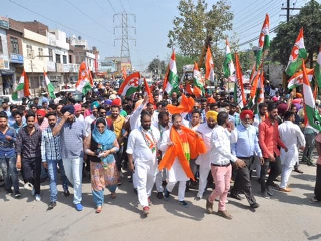 The Youth Congress workers during a road show in Batala on Friday.
