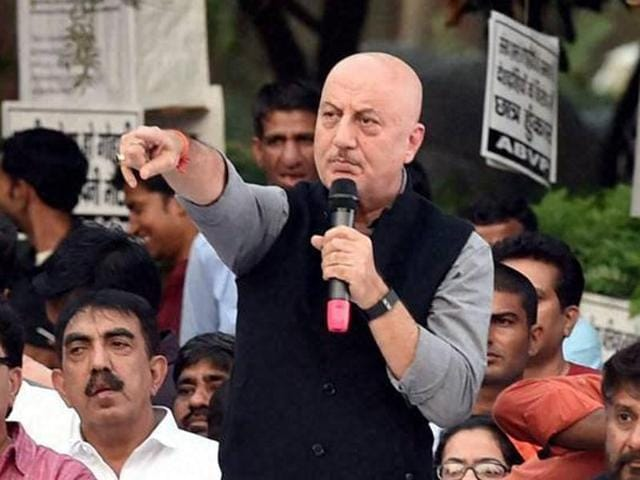 Bollywood actor Anupam Kher addresses the students before the screening of his film 'Buddha in a Traffic Jam' at JNU in New Delhi on Friday.