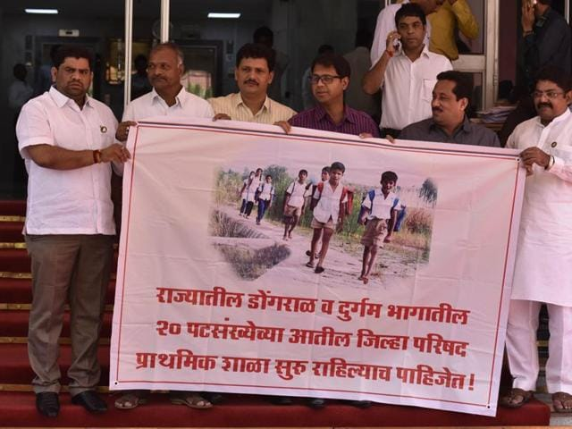 Shiv Sena MLAs demand compulsory school education for children living in hilly regions, at Vidhan Bhavan.
