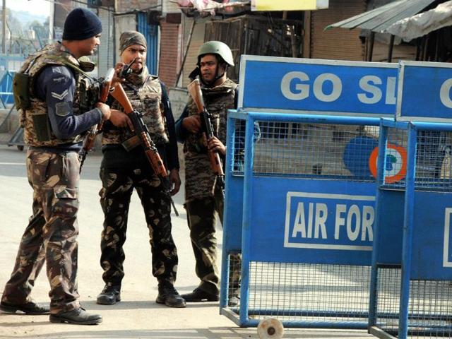 Security personnel stand outside the Pathankot air force base after the military operation against terrorists ended, in Punjab.