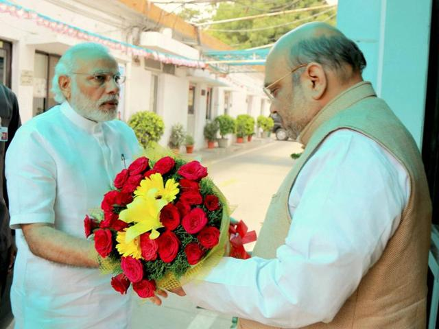 Prime Minister Narendra Modi being welcomed by BJP president Amit Shah at party office in New Delhi ahead of CEC meeting for West Bengal and Kerala on Thursday.