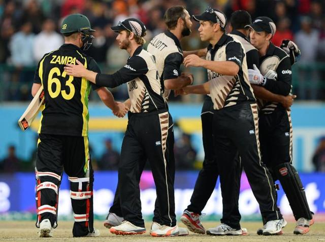 New Zealand players celebrate after winning the ICC World T20 match against Australia.