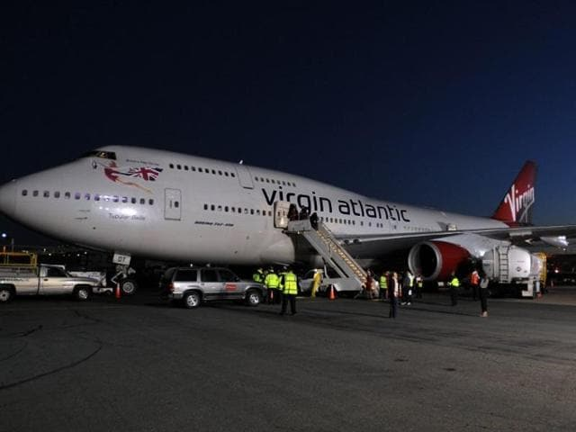 A Chinese woman was allegedly racially abused by a fellow passenger on a Virgin Atlantic flight.