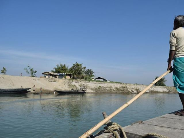 A ferry nears a sandbar ghat in Assam, India.