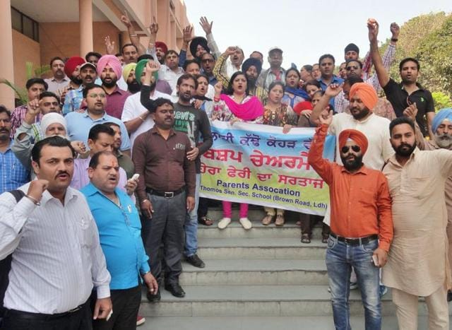 Parents staging a protest  outside the DC office in Ludhiana on Friday.