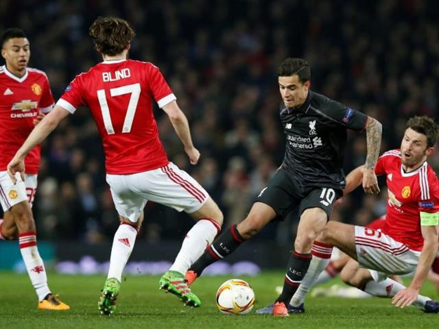 Liverpool's Philippe Coutinho in action with Manchester United's Michael Carrick and Daley Blind.