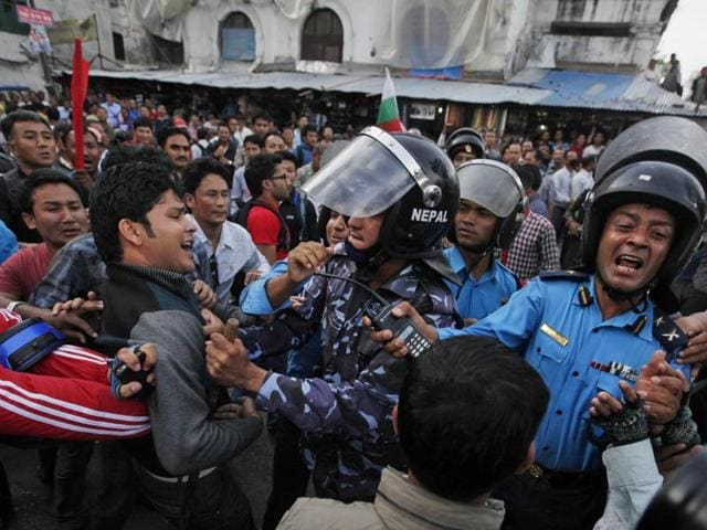 In this file photo from December 2015, Nepalese policemen use teargas to disperse ethnic Madhesi protesters in Gaur town south of Kathmandu.