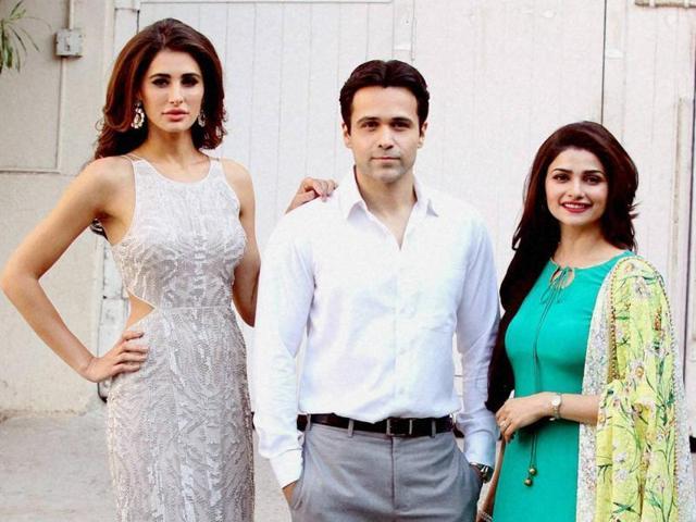 Nargis Fakhri, Emraan Hashmi and Prachi Desai during the poster photo shoot of film Azhar in Mumbai on Thursday.(PTI)