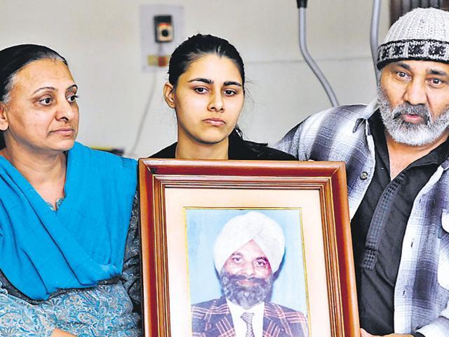 Arvind Kaur (left), daughter of slain engineer Avtar Singh, with her daughter Divya and husband Capt BS Guruney at their residence in SAS Nagar on Thursday.