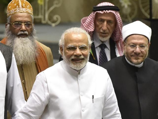 Prime Minister Narendra Modi with delegation at the inauguration of World Sufi Forum at Vigyan Bhavan in New Delhi on Thursday.
