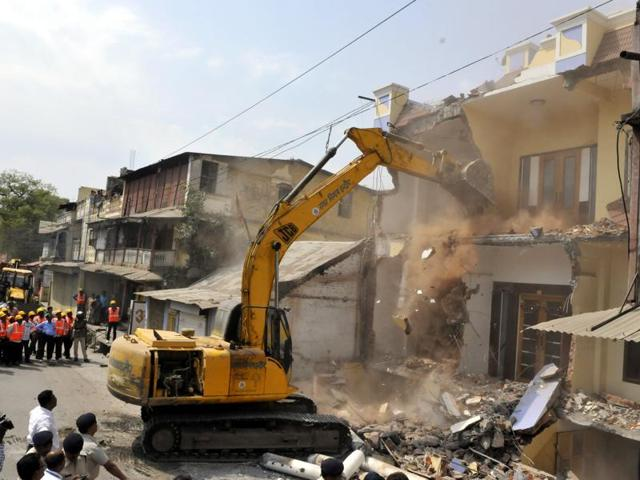 Demolition work underway to clear a block of residential flats in preparation for a block of flats.