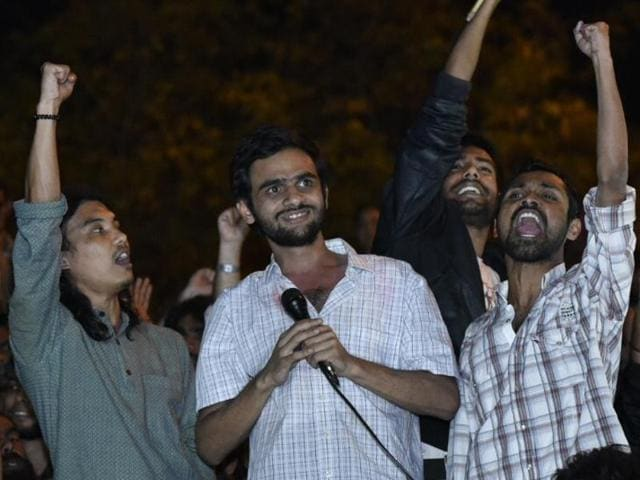 Umar Khalid with other JNU students in New Delhi after he was released from Tihar jail on interim jail on Friday.