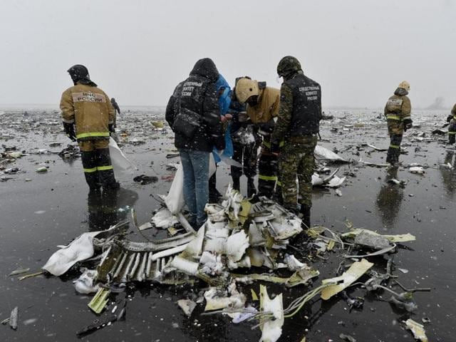 Emergencies ministry members and investigators work at the crash site of the Boeing 737-800 Flight FZ981 operated by Dubai-based budget carrier Flydubai, at the airport of Rostov-On-Don, Russia.