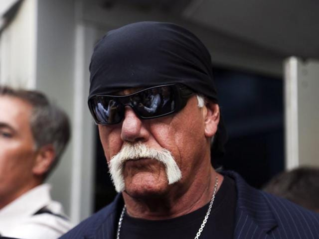 Hulk Hogan, centre, walks out of the Pinellas County courthouse with his attorneys in St. Petersburg.
