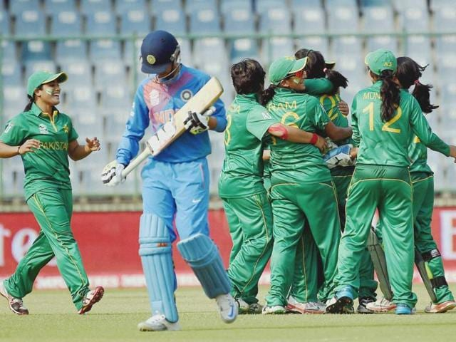 Pakistani women's cricket team celebrates the wicket of India's Smriti Vandhana during the World T20 match.