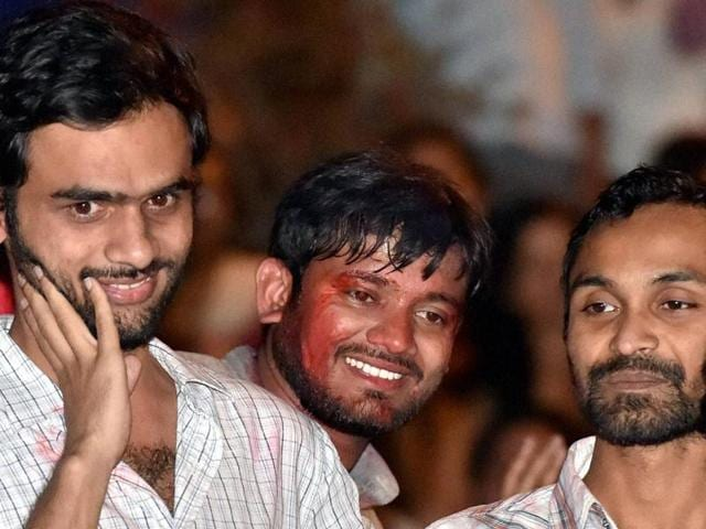 JNU student  Umar Khalid (with mike) with other students in New Delhiion Friday, March 18, 2016, after his release from jail on interim bail.