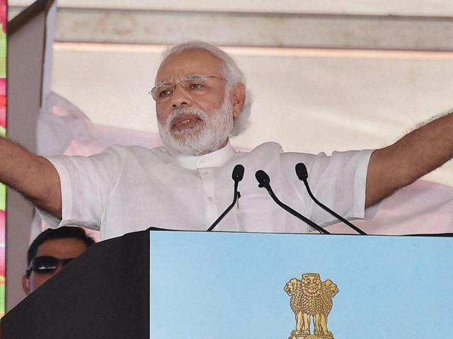 Prime Minister Narendra Modi giving away Krishi Karman Award to a Rajasthan farmer for outstanding performance in agriculture at Krishi Unnati Mela in New Delhi on Saturday.