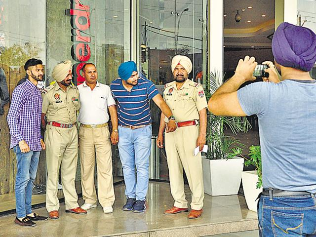 Cops and other members taking pictures during the mock exercise at Pavillion Mall in Ludhiana on Friday .