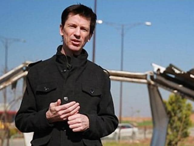 This photo posted online by the IS-affiliated Amaq News Agency shows British journalist John Cantlie during a stand-up for an IS propaganda video in Mosul, Iraq.
