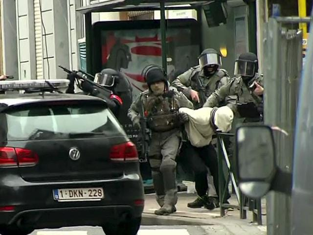 Armed Belgian police apprehend Salah Abdeslam, one of the main suspects from November's Paris attacks, in Molenbeek near Brussels, Belgium on Friday.