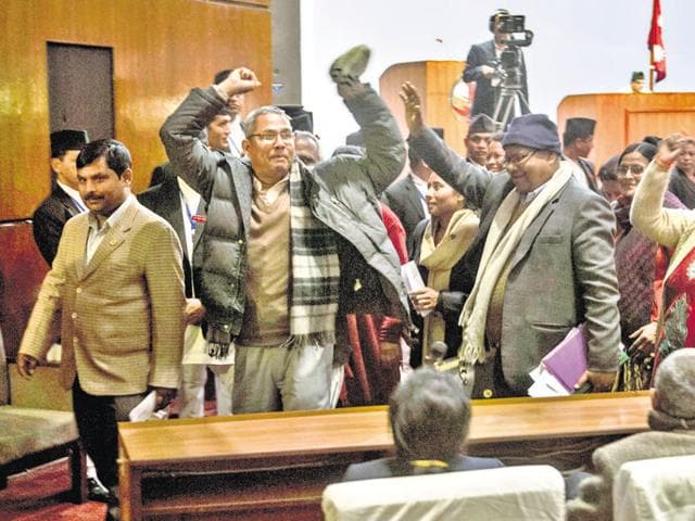 Nepalese lawmakers stage a protest as other lawmakers vote a constitution amendment bill in Kathmandu on January 23, 2016.
