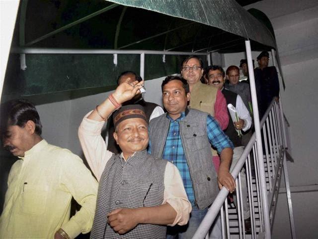 Uttarakhand political crisis,Rebel Congress MLAs join BJP,BJP