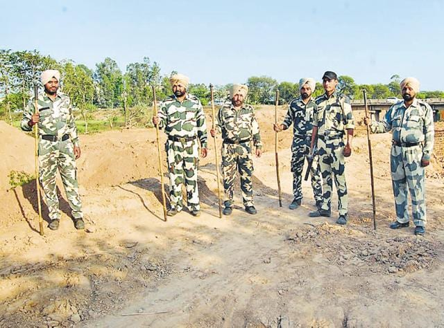 Security personnel deputed at the SYL canal site near Rajpura on Friday.