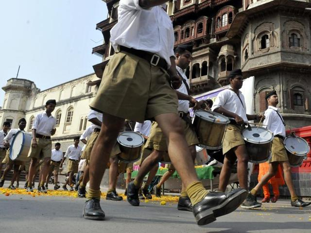 Rashtriya Swayamsevak Sangh (RSS) set to replace the billowing khaki shorts with coffee- brown pants as their uniform.  RSS volunteers at a rally in Pune on January 3, 2016.