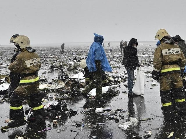 Russian emergency ministry employees are seen among the wreckage of a crashed plane at the Rostov-on-Don airport, about 950 kilometers (600 miles) south of Moscow, Russia.