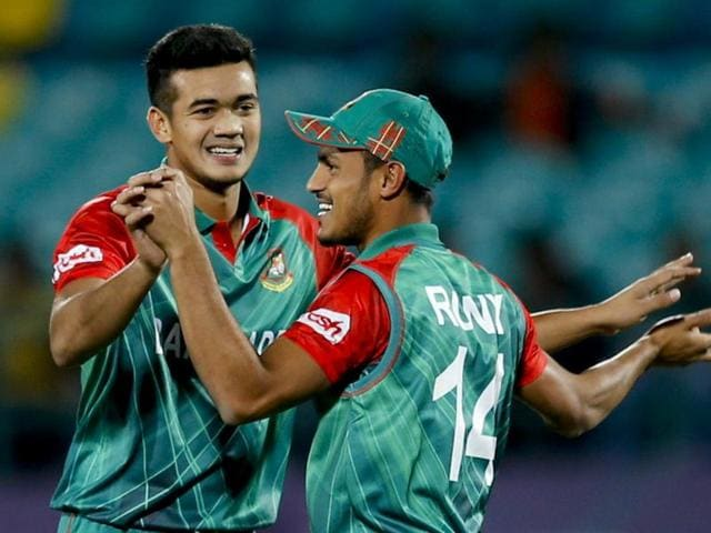 Bangladesh's Taskin Ahmed, left, celebrates the wicket of Oman's Zeeshan Maqsood during the ICC WT20.