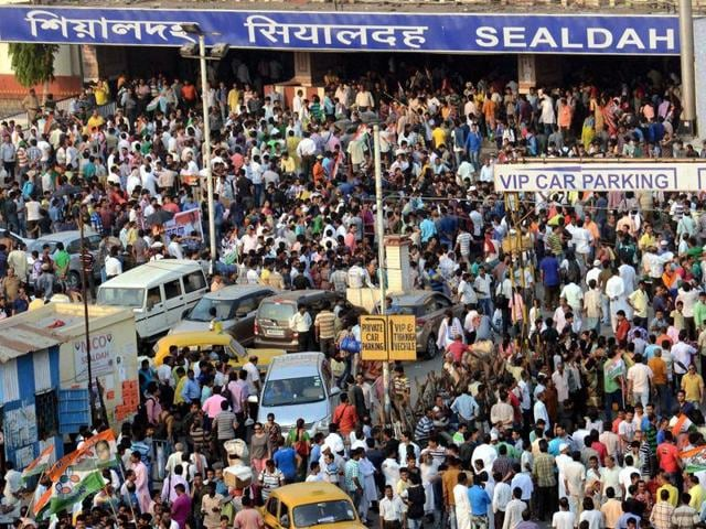 TMC workers during a protest rally against a TV channel whose sting operation showed their party leaders accepting bribe, at Sealdah railway station in Kolkata.