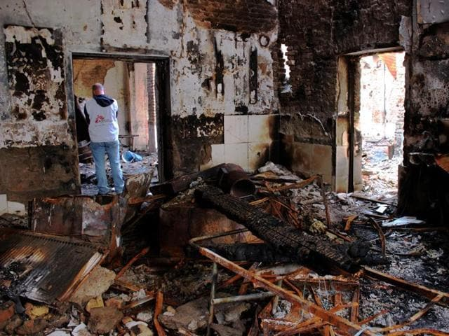 In this photograph taken on November 10 ,2015, staff members walk through the damaged Medecins Sans Frontieres (MSF) hospital in Afghanistan's city of Kunduz.