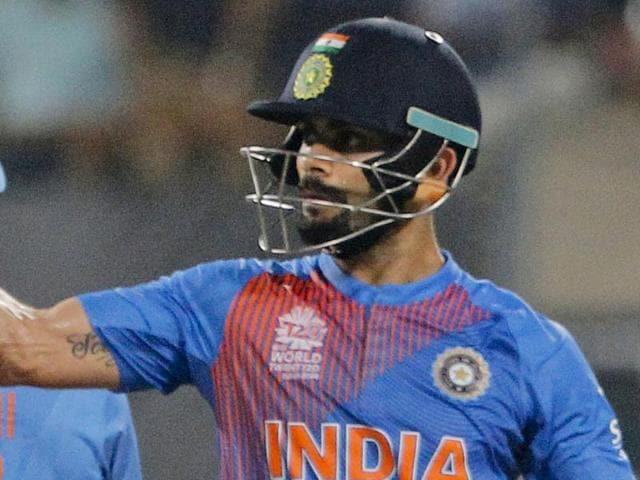 India's Virat Kohli celebrates his fifty runs during the ICC World Twenty20 2016 cricket match against Pakistan.