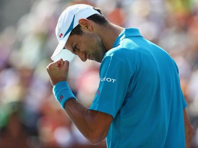 Novak Djokovic overcame a stern test from Rafael Nadal to set a title clash at Indian Wells against Canada's Milos Raonic.