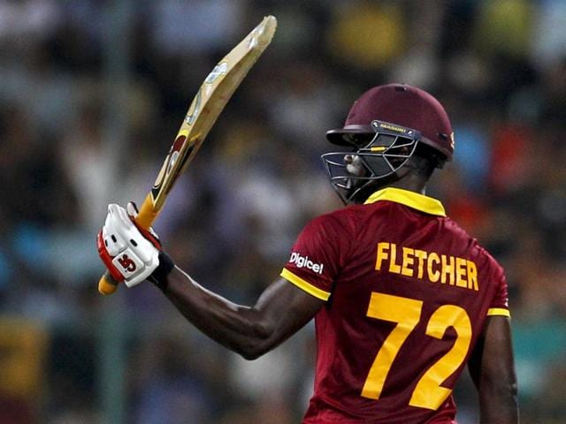 West Indies' Andre Fletcher raises his bat to celebrate scoring fifty runs during their ICC World Twenty20 2016.