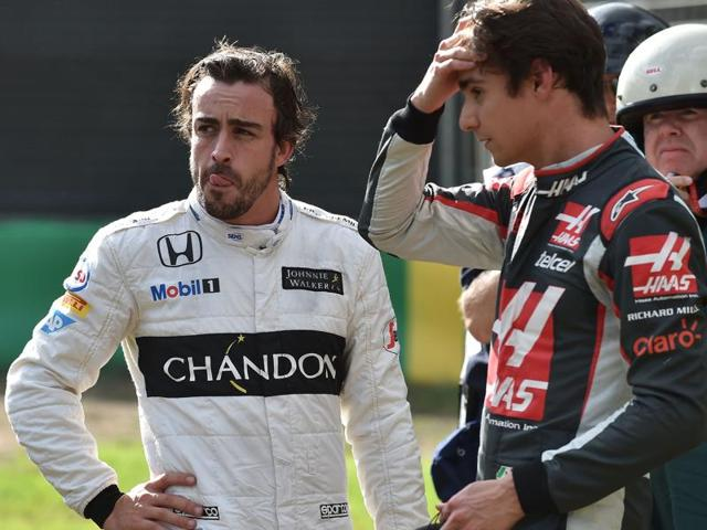 McLaren Honda's Spanish driver Fernando Alonso react after crashing during the Formula One Australian Grand Prix in Melbourne.
