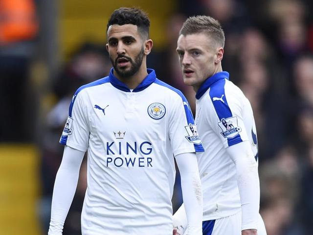 Riyad Mahrez celebrates with Jamie Vardy and Shinji Okazaki (R) after scoring the winner for Leicester City against Crystal Palace at Selhurst Park on March 19, 2016.