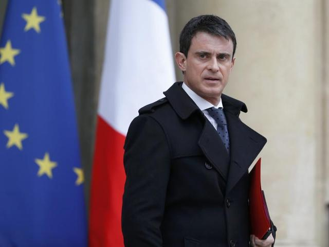 French Prime Minister Manuel Valls leaves after he attended a defence council at the Elysee Palace in Paris, France.