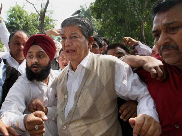 Congress leader Harish Rawat with his supporters at his residence in New Delhi.