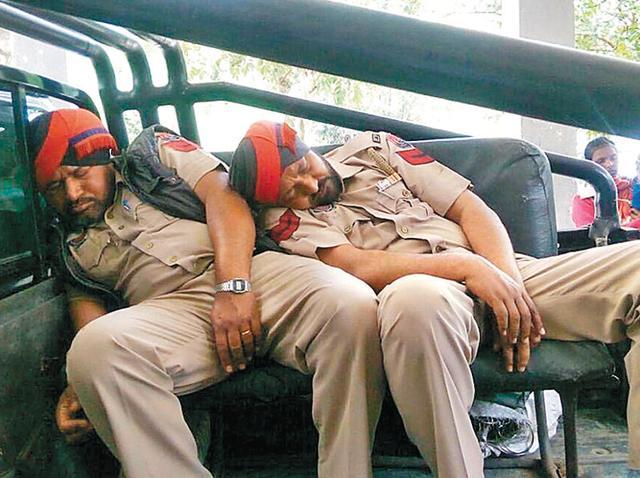 Unconscious policemen being taken to Guru Nanak Dev Hospital in Amritsar on Saturday.