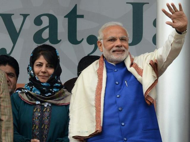 Prime Minister Narendra Modi with Peoples Democratic Party (PDP) leader Mehbooba Mufty during a rally in Jammu and Kashmir.