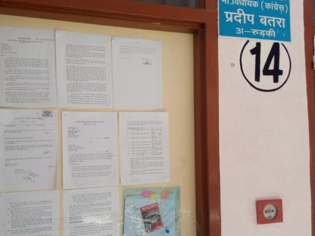 The wall of Congress MLA Pradeep Batra's house in Dehradun. The Uttarakhand Speaker issued notices to Batra and eight other rebel MLAs of the party for aligning with BJP.