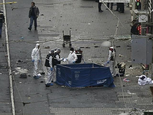 Security and forensic officials work at the explosion site in Istanbul.
