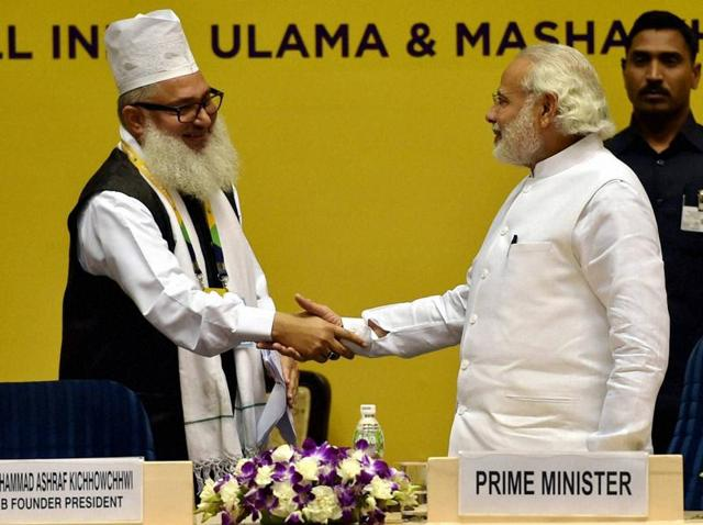Prime Minister Narendra Modi shakes hands with AIUMB president Syed Mohammad Ashraf at the opening ceremony of the World Sufi Forum, at Vigyan Bhawan in New Delhi.