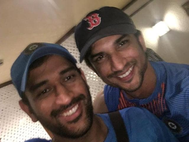 The two Dhonis celebrate India's win against Pakistan.