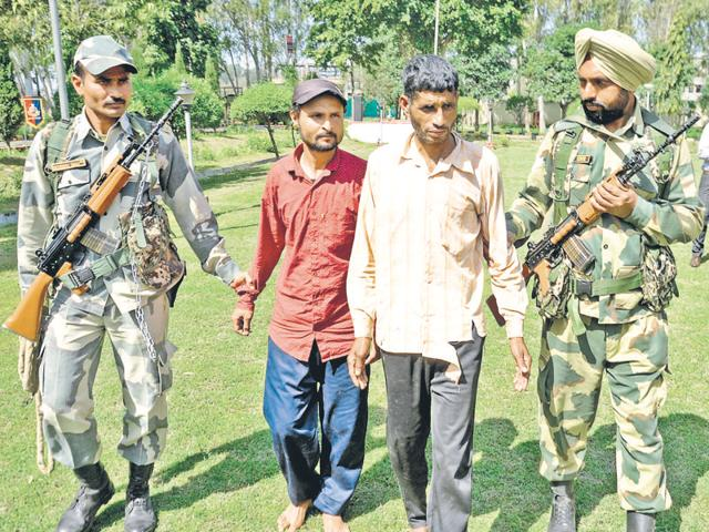BSF personnel with the accused duo at Ramtirath, about 15 km from Amritsar, on Sunday.