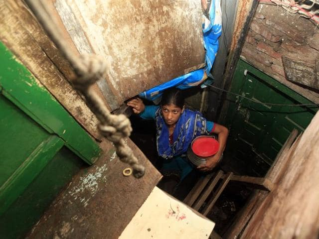 A seven-year-old struggles to drag a 12-litre water drum in Kaula Bunder. The 20% water cut has intensified the struggle for water here, forcing children to miss school so that they can help their parents fetch water from black-marketers in the neighbourhood.