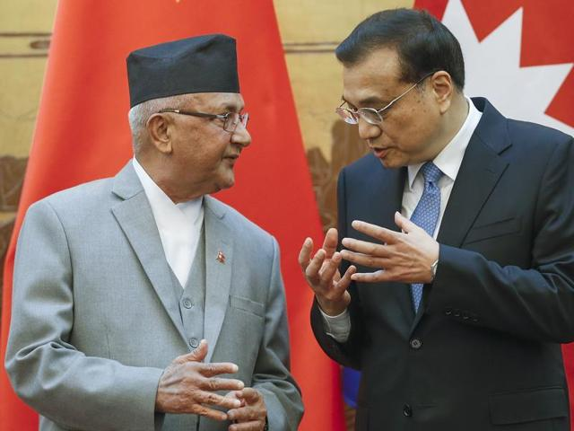 Chinese Premier Li Keqiang (right) speaks with Nepalese Prime Minister KP Sharma Oli during a signing ceremony at the Great Hall of the People in Beijing on Monday.